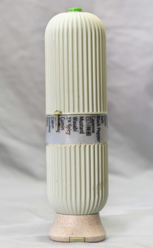 a vertical cylinder with text in the middle and a button on top